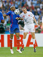 Photo: Glyn Thomas.<br />France v Switzerland. Group G, FIFA World Cup 2006. 13/06/2006.<br /> Arsenal teammates Thierry Henry (France,L) and Philippe Senderos (Switzerland,R) go up for the ball.