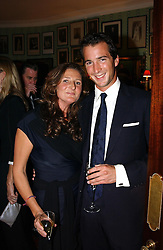 The HON.WILL ASTOR and KATHERINE IRELAND at a party for interior designer Katherine Ireland held at Marks club, 46 Charles Street, London W1 on 27th September 2004.<br /><br />NON EXCLUSIVE - WORLD RIGHTS