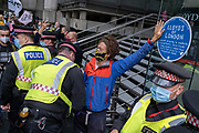 Extinction Rebellion Climate Change activists take their Environmental and Economy protest called The Walk of Shame to the City of London, the capitals financial district , on 4th September 2020, in London, England. According to XR, companies and institutions have profited from the slave trade and the profit from the exploitation of people and the planet. Companies on their tour of City insitutions such as Lloyds of London, Aviva Insurance and the Bank of England, are financing and insuring major fossil fuel projects, fuelling the climate and ecological emergency.