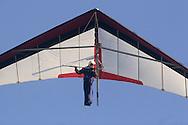 Ellenville, NY - A man flying a hang glider soars above Ellenvilleon May 30, 2009.
