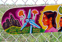USA, Chicago, August 25, 2009.  An environmentally-themed skateboard design, seen outside the fenced-off Celotex site, possible home for much-needed open space.The Little Village Environmental Justice Organization, headquartered in a predominantly Mexican-American neighborhood of Chicago, campaigns not only against pollution but for clean power, park facilities, urban agriculture, and restoring public transit. LVEJO's staff and volunteers make significant outreach and education efforts, especially for youth. Photo for an HOY feature story by Jay Dunn.
