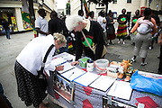 Rally in central London held by MDC every Saturday to protest against Robert Mugabe and his regime in Zimbabwe. Signing a petition.
