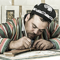 Bukhara, Uzbekistan 23 March 2012<br /> Bukharian artist Davlat Toshev paints a miniature in his atelier.<br /> Bukhara of the 16th century attracted skilled craftsman of calligraphy and miniature-paintings making of this region the hub of arts.<br /> PHOTO: EZEQUIEL SCAGNETTI