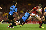 Scott Williams  of Wales is tackled by Felipe Berchesi of Uruguay ©. Rugby World Cup 2015 pool A match, Wales v Uruguay at the Millennium Stadium in Cardiff, South Wales  on Sunday 20th September 2015.<br /> pic by  Andrew Orchard, Andrew Orchard sports photography.