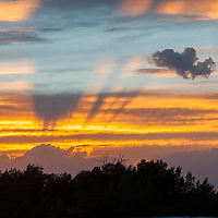 A sunset illuminates clouds over the southern Gallatin Valley, near Bozeman, Montana.