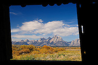 Window View of Grand Tetons from the Rustic Cunningham Cabin. Image taken with a Nikon D2xs and 12-24 mm f/4 lens (ISO 100, 24 mm, f/11, 1/60 sec).  While attending Nikonians ANPAT 7 in Grand Teton National Park and Yellowstone National Park in the Fall of 2007.