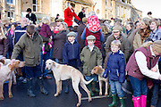 Locals gather in the square in Stow-on-the-Wold, Gloucestershire for the Heythrop Hunt New Year's Day Hunt Meet, The Cotswolds, UK