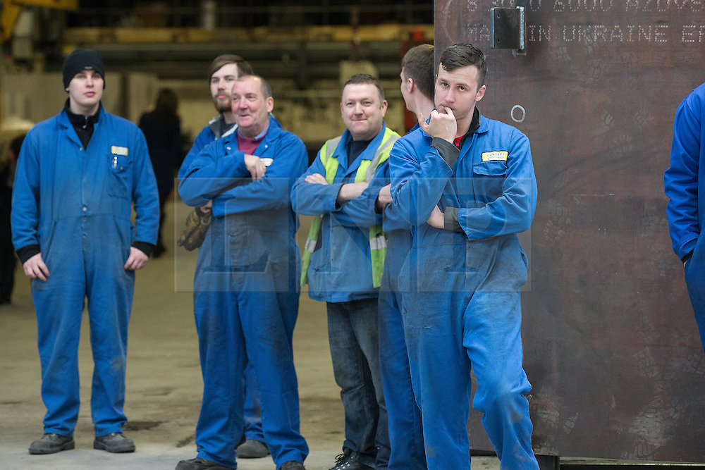 © Licensed to London News Pictures . 23/03/2015 . Middleton , UK . Sheet metal workers at the factory listen to Nigel Farage speak . UKIP leader Nigel Farage , Deputy Leader Paul Nuttall and Economics Spokesman Patrick O'Flynn announce UKIP's economic policy at Concept Metal Products and Co Ltd in Middleton , Lancashire . Photo credit : Joel Goodman/LNP