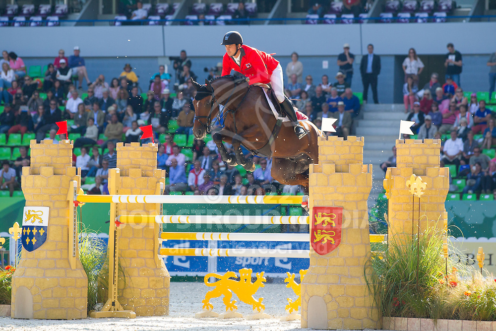 Steve Guerdat, (SUI), Nino Des Buissonnets - First Round Team Competition Jumping Speed - Alltech FEI World Equestrian Games™ 2014 - Normandy, France.<br /> © Hippo Foto Team - Leanjo De Koster<br /> 03-09-14