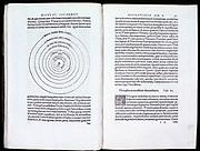Nicolas Copernicus (1473-1543) Polish astronomer.  Spread of his 'De revolutionibus orbium coelestium' Nuremberg 1543, showing diagram of his heliocentric (sun-centred) theory of the universe.
