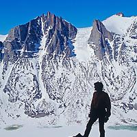 BAFFIN ISLAND, Nunavut, Canada, Alex Lowe surveys unnamed peaks & frozen lake in remote Stewart Valley during rock climbing expedition to Great Sail Peak.