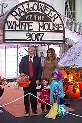 United States President Donald J. Trump and First Lady Melania Trump give out treats during a Halloween event at The White House in Washington, DC, October 30, 2017. 30 Oct 2017 Pictured: United States President Donald J. Trump and First Lady Melania Trump pose for photos while giving out treats during a Halloween event at The White House in Washington, DC, October 30, 2017. Credit: Chris Kleponis / CNP. Photo credit: Chris Kleponis - CNP / MEGA TheMegaAgency.com +1 888 505 6342