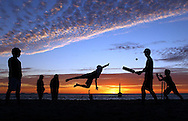Cat 5 - SPORT .Paul Kane.Getty Images.Young children play beach cricket at Cottesloe Beach.