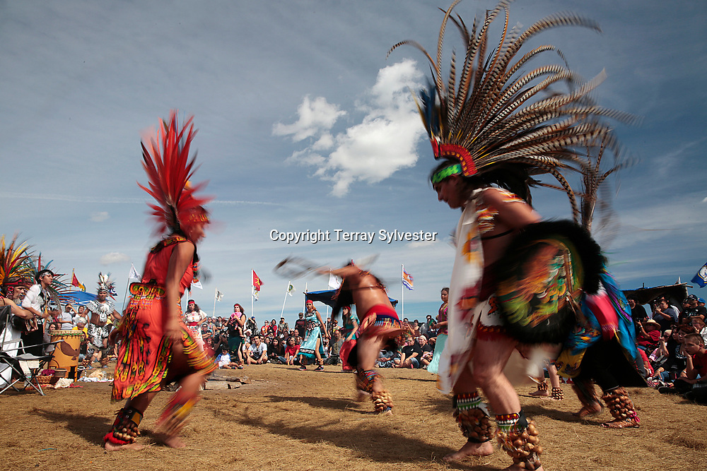 Maryanne Quiroz (left) Jorge Garcia (right) perform with a troupe of Aztec dancers in the opposition camp against the Dakota Access oil pipeline on September 10, 2016. Cannon Ball, North Dakota, United States.