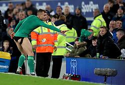Watford's Gerard Deulofeu throws his shorts into the crowd