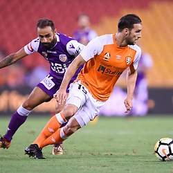 BRISBANE, AUSTRALIA - DECEMBER 21: Jack Hingert of the Roar evades the tackle of Diego Castro of the Glory during the Round 12 Hyundai A-League match between Brisbane Roar and Perth Glory on December 21, 2017 in Brisbane, Australia. (Photo by Patrick Kearney / Brisbane Roar FC)