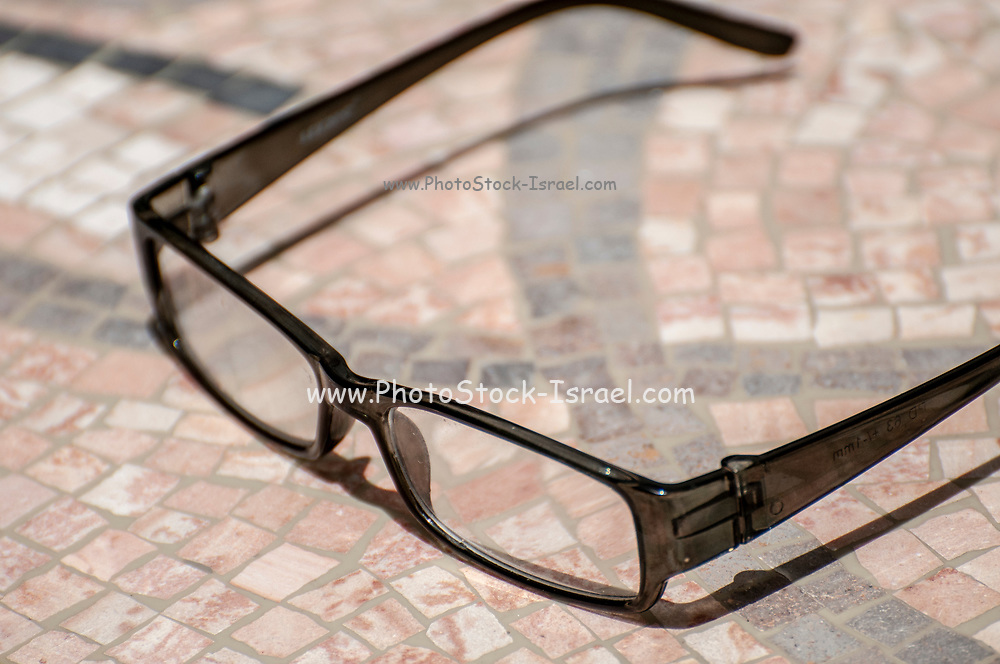 reading glasses on a mosaic table