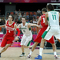 02 August 2012: Russia Alexey Shved drives past Marcelinho Huertas on a screen set by Victor Khryapa during 75-74 Team Russia victory over Team Brazil, during the men's basketball preliminary, at the Basketball Arena, in London, Great Britain.