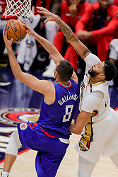 October 23, 2018 - New Orleans, LA, U.S. - NEW ORLEANS, LA - OCTOBER 23:  New Orleans Pelicans forward Anthony Davis (23) reaches to block the ball against LA Clippers forward Danilo Gallinari (8) on October 23, 2018, at Smoothie King Center in New Orleans, LA. (Photo by Stephen Lew/Icon Sportswire) (Credit Image: © Stephen Lew/Icon SMI via ZUMA Press)