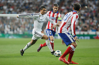 Real Madrid's Cristiano Ronaldo (L) and Atletico del Madrid´s Gabi during quarterfinal second leg Champions League soccer match at Santiago Bernabeu stadium in Madrid, Spain. April 22, 2015. (ALTERPHOTOS/Victor Blanco)