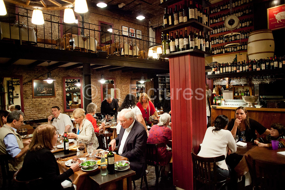 People sitting down to dinner at Don Julio Parilla, a famous steak house in Palermo, Buenos Aires, Federal District, Argentina.