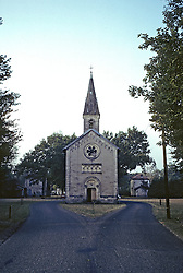 Small Village Church With Road Wrapping Around It