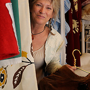 """Christine Detroy, a Brunswick artist, is passionate about making things from found fabrics and objects on the beach. """"I come in here to play,"""" she says of her Fort Andross studio. Photo by Roger S. Duncan."""