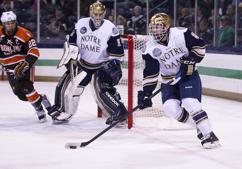 March 15, 2013:  Notre Dame defenseman Sam Calabrese (8) skates with the puck during NCAA Hockey game action between the Notre Dame Fighting Irish and the Bowling Green Falcons at Compton Family Ice Arena in South Bend, Indiana.  Notre Dame defeated Bowling Green 1-0 in overtime.