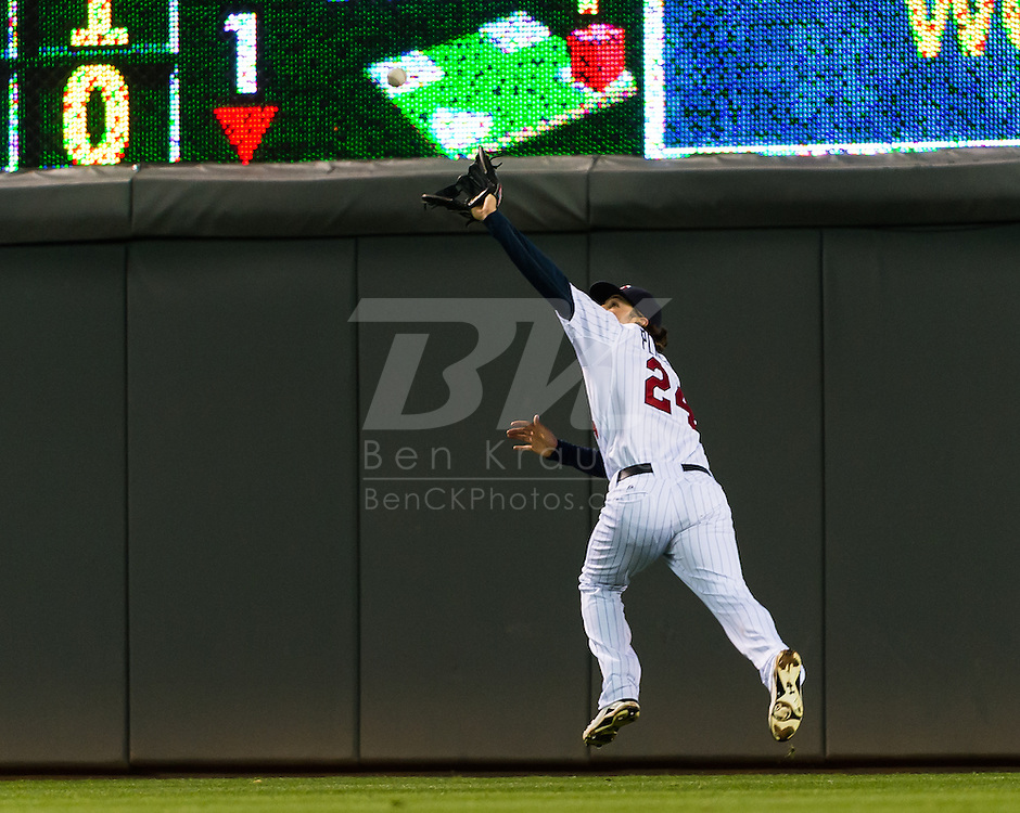 Minnesota Twins Trevor Plouffe makes a catch in right field against the Los Angeles Angels on May 8, 2012 at Target Field in Minneapolis, Minnesota.  The Twins defeated the Angels 5 to 0. © 2012 Ben Krause