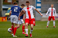 Cameron Logan (Heat of Midlothian) wins the ball from Kacper Kozlowski during the U17 European Championships match between Scotland and Poland at Firhill Stadium, Maryhill, Scotland on 26 March 2019.