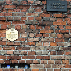 Warsaw, Poland - May, 2009 - A fragment of the remaining wall that once surrounded the Warsaw Ghetto, housed out of sight in an apartment building's courtyard off of Ul Sienna 55..Photo © Susana Raab 2009