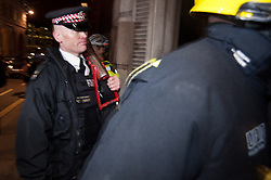 © licensed to London News Pictures. London, UK. 27/01/12. Police leave with battering ram. Protestors cleared from new site in the City of London. The 'Bank of Ideas' group, who had occupied the disused Bank of Iraq building at 7-10 Leadenhall, are cleared after it emerged the building is a diplomatic premises under Section 9 of the 1977 Criminal Law Act. Fire services cleared the street after finding a strong smell of Diesel upon entry to the premises and cleared. Photo credit: Jules Mattsson/LNP