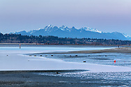 The Golden Ears (Mount Blanshard) and Mud Bay (Boundary Bay) after sunset.  Photographed from Blackie Spit at Crescent Beach, Surrey, British Columbia, Canada