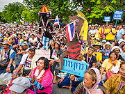 16 MAY 2014 - BANGKOK, THAILAND: Protestors, some with large shadow puppets from Thai mythology sit in the street in front of the Thai parliament complex in Bangkok. Thousands of protestors from the People's Democratic Reform Committee (PDRC) surrounded the Thai Parliament complex Saturday to pressure the Thai Senate to select an interim Prime Minister to replace ousted former PM Yingluck Shinawatra. The Senate decided not to appoint an interim PM of their own and announced a meeting with the current interim Prime Minister. The protestors left the parliament complex and threatened to return in larger numbers if the Senate doesn't act. The Senate appointment of an acting PM could plunge Thailand into chaos since there is already an interim Prime Minister from the ruling Pheu Thai party.     PHOTO BY JACK KURTZ