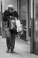 Woman walking home from Market.