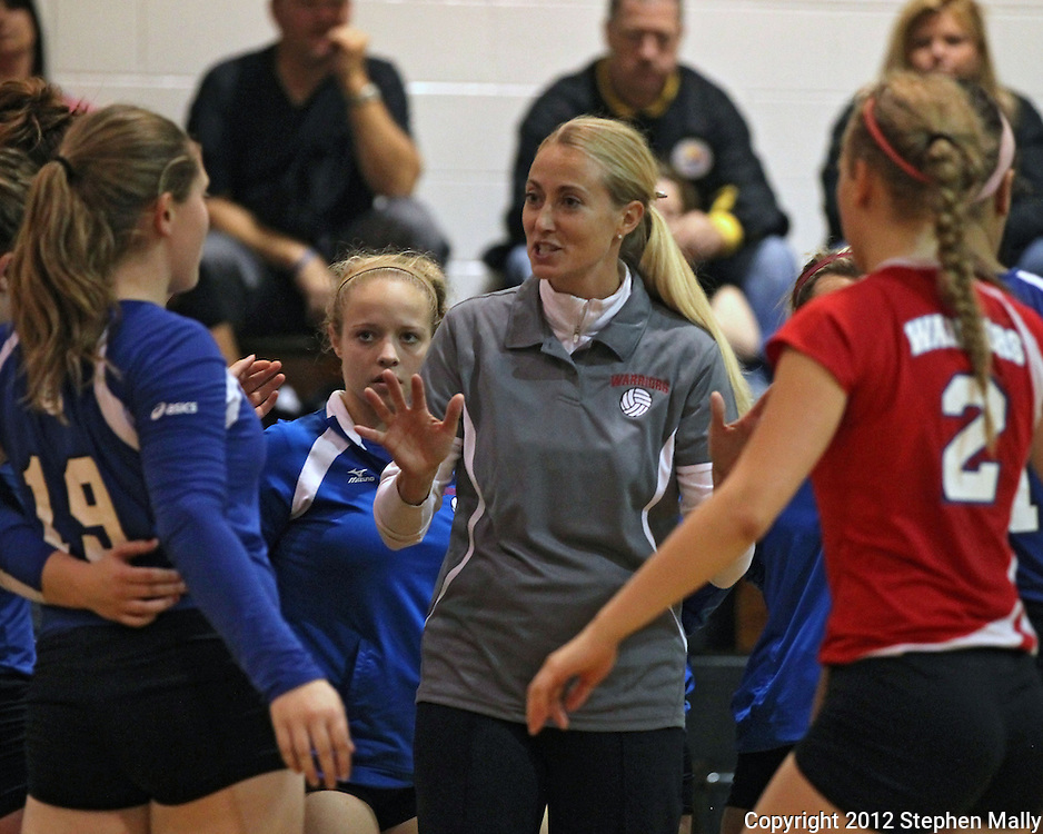 Washington head coach Kari Lombardi talks to her team during a timeout during the MVC Volleyball Tournament semifinal game between the Wahlert Golden Eagles and the Washington Warriors at Kennedy High School in Cedar Rapids on Saturday October 13, 2012. Washington defeated Wahlert 25-13, 25-20.