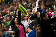 Citizens hold up signs while U.S. Rep. Michael C. Burgess speaks during a town hall meeting within his district at Flower Mound Marcus High School in Flower Mound, Texas on March 4, 2017.  (Cooper Neill for The Texas Tribune)