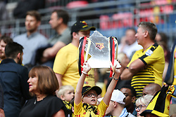 A watford fan with a tin foil FA Cup trophy before kick off - Mandatory by-line: Arron Gent/JMP - 18/05/2019 - FOOTBALL - Wembley Stadium - London, England - Manchester City v Watford - Emirates FA Cup Final- Mandatory by-line: Arron Gent/JMP - 18/05/2019 - FOOTBALL - Wembley Stadium - London, England - Manchester City v Watford - Emirates FA Cup Final