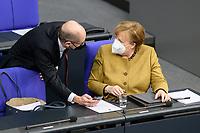 11 FEB 2021, BERLIN/GERMANY:<br /> Olaf Scholz (L), SPD, Bundesfinanzminister, und Angela Merkel (R), CDU, Bundeskanzlerin, im Gespraech, waehrend der Debatte nach Merkels Regierungserklaerung zur Bewaeltigung der Corvid-19-Pandemie, Plenum, Reichstagsgebaeude, Deutscher Bundestag<br /> IMAGE: 20210211-01-091<br /> KEYWORDS: Corona, Mundschutz, Maske, Gespräch