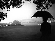 Photography of Sydney by Paul E  Green,rainy night, view of Sydney Opera House and Sydney Harbour bridge, from Mrs Macquarie's Chair, Black and white