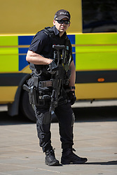 © Licensed to London News Pictures . 19/05/2018. Manchester, UK. Armed police on patrol in Manchester City Centre as the Football Lads Alliance demonstrate in Manchester , three days before the first anniversary of the Manchester Arena terror attack . Photo credit: Joel Goodman/LNP