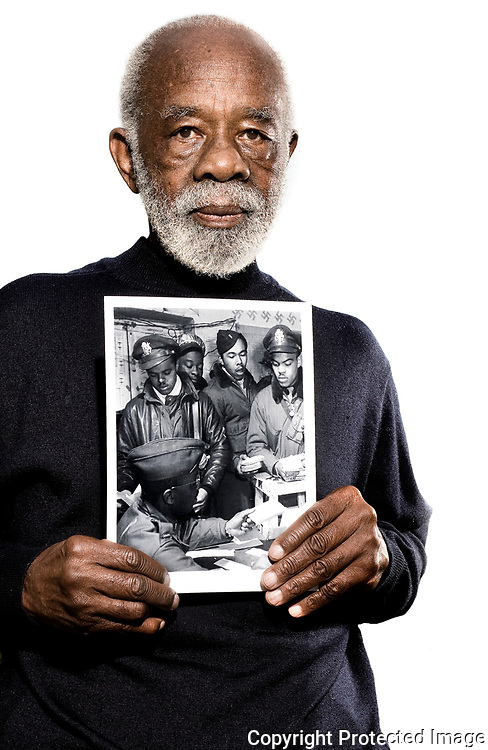 Tuskegee Airmen holding photo of himself