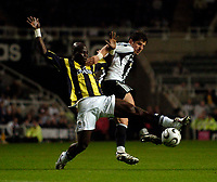Photo: Jed Wee.<br /> Newcastle United v Fenerbahce. UEFA Cup. 19/10/2006.<br /> <br /> Fenerbahce's Stephen Appiah (L) and Newcastle's Emre challenge for possession.