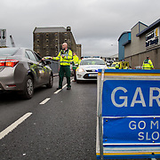 14.11.2016          <br /> Major winter safety and wellbeing campaign launched by Limericks Public Services. <br /> <br /> John Holland, National Ambulance service hands out information leaflets during a combined checkpoint between Limerick City and County Council, the HSE and An Garda Siochana on the Dock Road Limerick. Picture: Alan Place