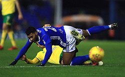Birmingham City's David Davis (top) and Norwich City's Tom Trybull battle for the ball