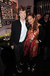 MICK JAGGER and daughter JADE JAGGER at the opening of Jade Jagger's shop at 43 All Saints Road, London W11 on 25th November 2009.