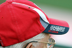11 July 2012:  A St. Louis Cardinals baseball cap adorns the head of an elderly gentleman during the Frontier League All Star Baseball game at Corn Crib Stadium on the campus of Heartland Community College in Normal Illinois