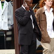 NLD/Amsterdam/20050611 - Indiaase filmster Saif Ali Khan en vriendin wandelend door Amsterdam met beveiliging