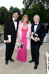 Left to right, MARK STEWART, LADY STEWART and SIR JACKIE STEWART at The Animal Ball in aid of The Elephant Family held at Lancaster House, London on 9th July 2013.