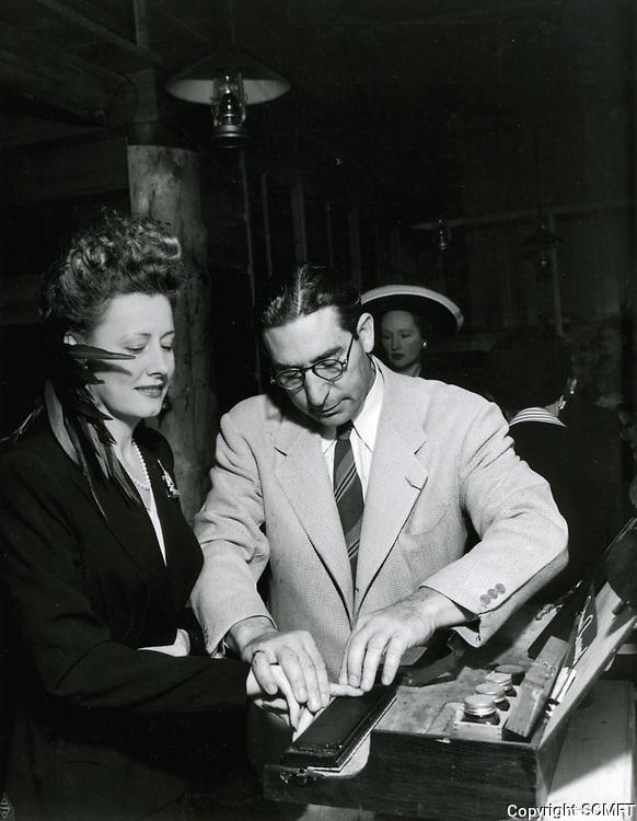 1942 Irene Dunne being fingerprinted as a Hollywood Canteen volunteer